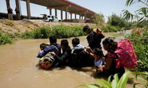 Migrants from Guatemala cross the Rio Bravo