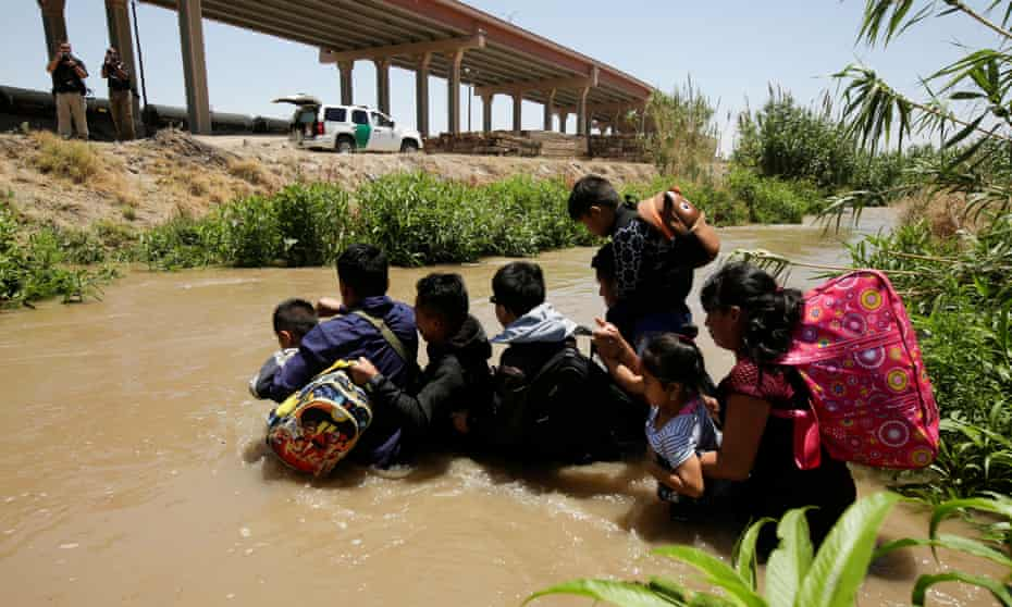 Migrants from Guatemala cross the Rio Bravo