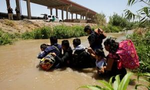 Migrants from Guatemala cross the Rio Bravo river to enter the US illegally in El Paso, Texas.