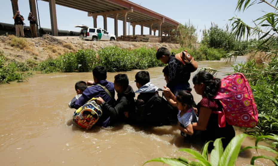 Migrants from Guatemala cross the Rio Bravo river to enter the US illegally in El Paso, Texas.