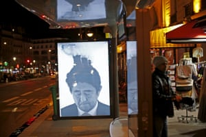 A poster by street artist Bill Posters of Japan's Prime Minister Shinzo Abe