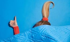 woman under weighted blanket