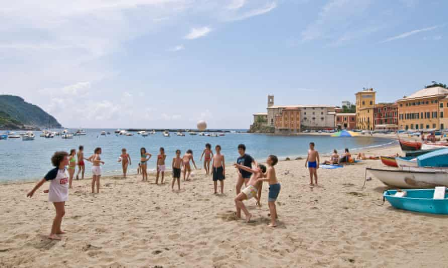 Kids playing with the ball at the beach of Bay of Silence Sestri Levante Province of Genoa, Italy