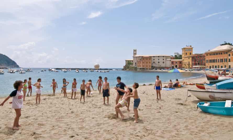 Children play on the beach of Sestri Levante, Italy.