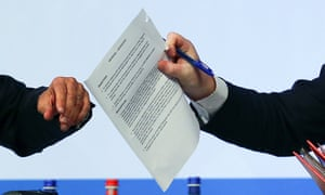 Foreign secretary holds the document marked sensitive.