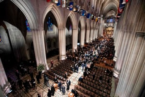 Visitors gather for the funeral service at the National Cathedral in Washington DC.
