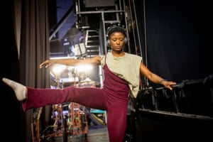 Janique Charles, who plays Nala, dancing and stretching in the wings