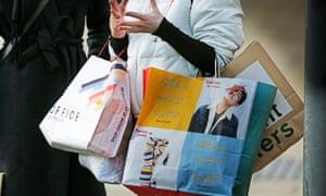 woman partially visible with shopping bags