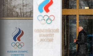 Man walks past Russian Olympic Committee headquarters in Moscow