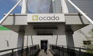 A man leaves the Ocado customer fulfilment centre