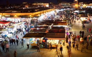 The hustle and bustle of the famous Jemaa el-Fnaa square in Marrakech, seen from a cafe rooftop.