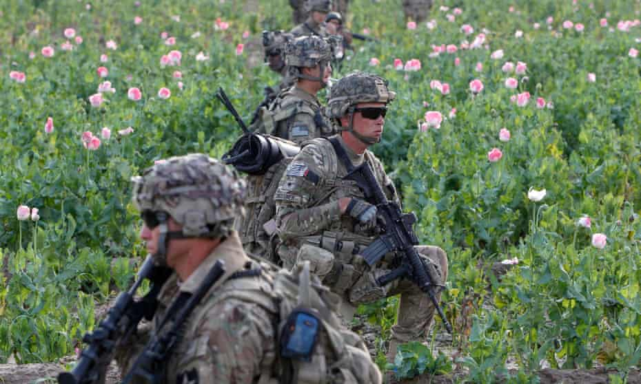 US and Afghan soldiers patrol in Zharay district in Kandahar province, southern Afghanistan.
