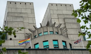 A rainbow flag flies outside the MI6 building in London.