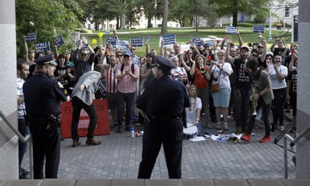 Protesters gather outside the North Carolina museum of history as the governor makes remarks about HB2 during a government affairs conference in Raleigh.