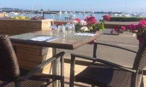 outside table overlooking harbour at Le Brise Lames restaurant, Roscoff, France.