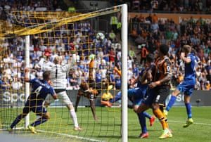 Abel Hernandez and Diomande both go for the shot after Schmeichel's save.