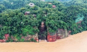 The Leshan Giant Buddha surrounded by floodwaters.