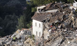 Rescuers search for survivors in collapsed buildings in Pescara del Tronto