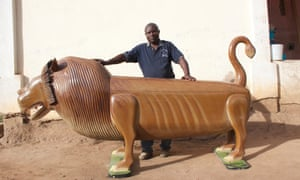 Paa Joe with a lion coffin.