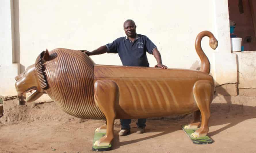 Paa Joe with a lion coffin.