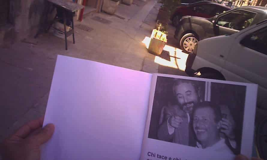 Alleged mafia pizzo collector is filmed being shown documents including a photo of Giovanni Falcone and Paolo Borsellino