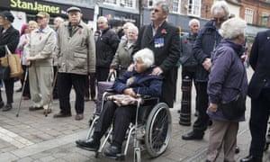 In Newbury, Berkshire, 89-year-old Meida Chun wears her late husband Geoffrey's medals