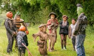 Worzel Gummidge cast in a field