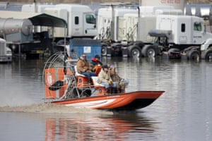 Glenn Wyles, Gabe Schmidt, Juan Jacobo, Mitch Snyder, Gabe Schmidt, owner of Liquid Trucking, top right, travels by air boat to survey damage from the flood waters of the Platte River, in Plattsmouth, Neb., Sunday, March 17, 2019