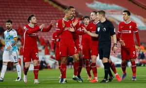 Liverpool players remonstrate with the referee after he awards a penalty