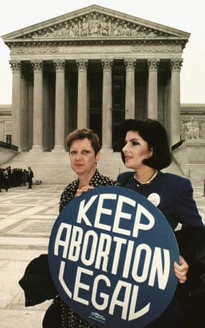 Norma McCorvey, formally known as 'Jane Roe', with Gloria Allred in front of the US supreme court building on 26 April 1989, just before attorneys began arguing the 1973 landmark abortion decision.