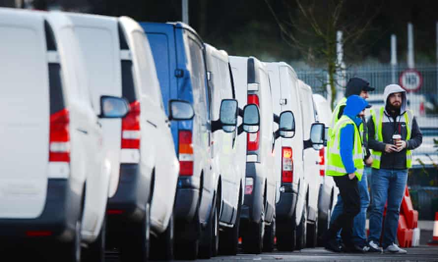 Drivers wait to pick up parcels on Black Friday at an Amazon fulfilment centre in Dunstable.
