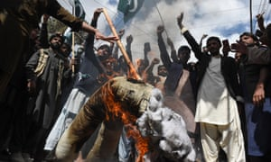 Pakistani protesters burn an effigy of the Indian prime minister, Narendra Modi.