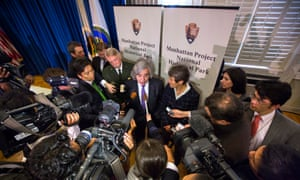 Sally Jewell and Ernest Moniz speak to members of the Japanese media after holding a signing ceremony to establish the Manhattan Project national historic park.
