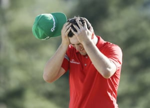 Jon Rahm reacts after a triple bogey on the 18th
