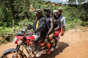Traditional Mai Mai militiamen ride on a motorcycle in the village of Mabuku in Eastern Democratic Republic of Congo, an area best by armed groups. Some Mai Mai groups have attacked Ebola Treatment centres and have threatened to kill Ebola responders. A WHO doctor was shot and killed by attackers at a hospital in Butembo in April, but in Mabuku, Mai Mai fighters granted health workers escorted by government soldiers access to the village where there have been seven confirmed cases in the past two weeks, including four deaths