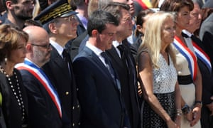 Manuel Valls (centre) observes a minute's silence on the Promenade des Anglais in Nice on Monday