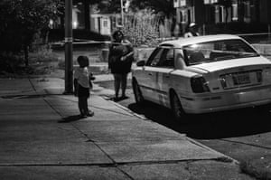 A child stops to look at a car involved in a late-night shooting on Ashland Avenue on 28 July 2013