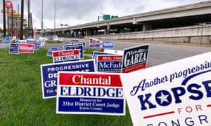 Political campaign signs stand outside a polling station in Austin, Texas Monday.