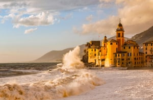 Rough waves lash Camogli, a picturesque town in Liguria, Italy