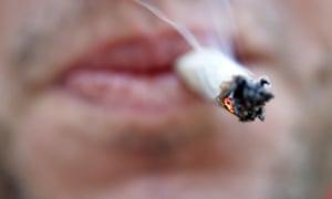 A man smokes a cannabis joint