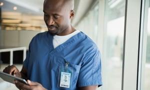 Surgeon using digital tablet at window