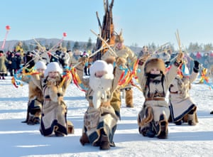Women of the Oroqen ethnic group dance during an ice and snow festival in the Inner Mongolia autonomous region of China