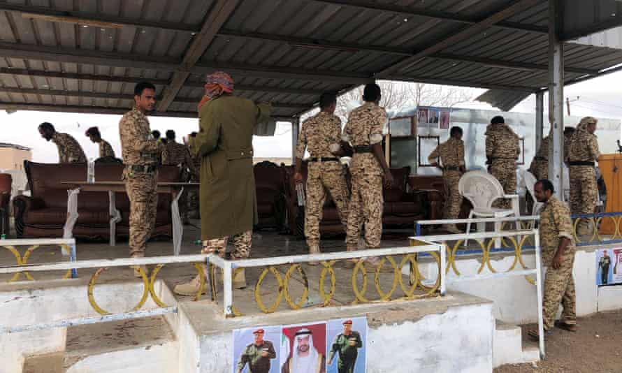 Soldiers inspect the scene of the Houthi drone attack at a military parade.