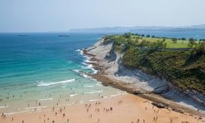 Locals and tourists enjoy hot August weather on Beach Playa de Matalenas