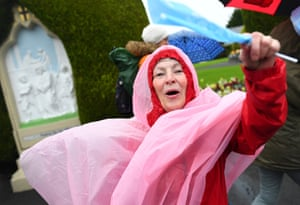 A woman waits in the rain ahead of a visit by Pope Francis Ireland