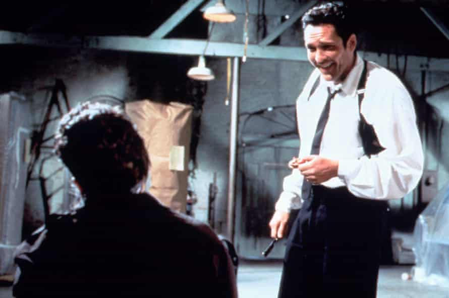 Michael Madsen in Reservoir Dogs, which used the song Stuck in the Middle With You to great effect.