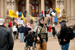 People protest Michigan's stay-at-home order at the state Capitol in April.