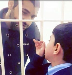 Death-row prisoner Mohammed Ramadan, pictured in prison in Bahrain with his son, was allegedly tortured.