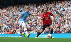 Aoife Mannion closes down Ella Toone in the Manchester derby on the opening day of the season.