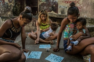 Mothers aged between 16 and 18, who live in the building, play bingo using black beans as chips